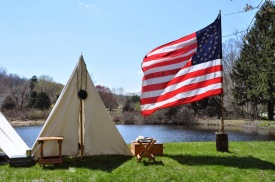 Re-enactment camp by the pond
