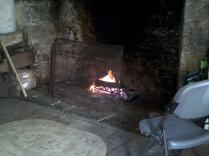 hearth fire in the kitchen of the main house